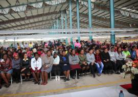 Over 300 textile workers listening to presentations during the World Mental Health Day commemoration at the factory.