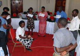 A Training of the Trainers session on strengthening the health sector's response to violence against women in Uganda. Participants learn how to improve their referral plans by learning about the difficulties survivors face when being referred to various services.