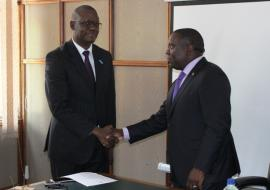 The WHO Representative, Dr. Nathan Nsubuga Bakyaita (left) shaking hands with the Minister of Forein Affairs Hon. Harry Kalaba after presenting letters of credence.