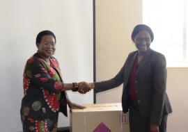 OIC Zimbabwe, Dr Juliet Nabyonga handing over the kits to Dr Portia Manangazira, Director Epidemiolgy and Disease Control in Ministry of Health and Child Care