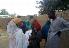 Community Health Champion educating household members on the common household diseases and preventive measures. Photo  WHO NOA, Borno state.