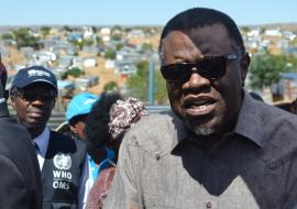The President of the Republic of Namibia, His Excellency Dr Hage Geingob addressing the community of Havana informal settlement while the WHO Country Representative Dr Charles Sagoe-Moses looks on