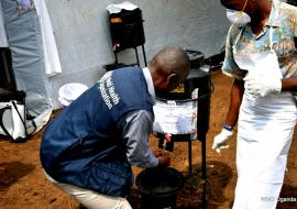 WHO official demonstrates proper hand-washing at Kasango Cholera treatment center in Kyangwali refugee camp