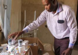 Umar Musami, Psychiatrist, Federal Neuro Psychiatric Hospital looking at medication for mental disorders in Bakass Camp in early March 2018