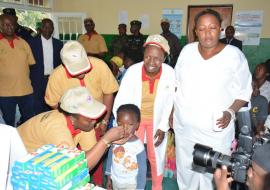 Launching of MCH Week, Minister of Health, Dr Diane Gashumba administering a deworming tablet to a child