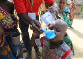 Eligible child being administered with  anti-malaria drug during 2017 SMC campaign in Borno state. Photo credit: WHO/CE.Onuekwe