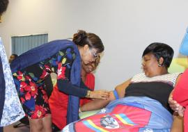 The Honourable Minister of Health, Senator Sibongile Ndlela Simelane donating blood with assisted by from the WHO Country Representative, Dr Tigest Ketsela Mengestu