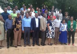 Training participants and facilitators in a group photo