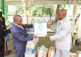 The Permanent Secretary for Health, Dr Mpoki Ulisubisya receiving the items from the WHO Representative, Dr. Adiele Onyeze