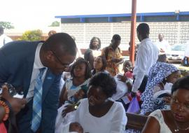 Dr Kaluwa interacts with a nursing mother at a Postnatal Clinic