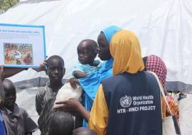 WHO personnel raising awareness on proper hygiene and prevention against cholera
