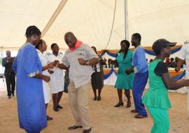 Honorable MP for Norton, Temba Mliswa dancing with some of the psychiatric patients during the launch
