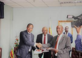Honorable Minister of Finance and Economic Development Prof. Mthuli Ncube and WR Dr Gasasira shaking hands after signing for the grant