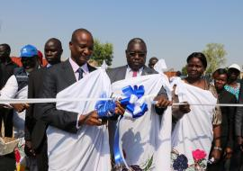 H.E Gen Taban Deng Gai cuts the ribbon during the opening of the IDU