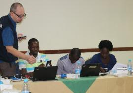 Dr. Boris Pavlin, WHO Epidemiologist  demonstrates the use of an EWARS mobile phone during the training
