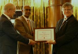 Dr Rudi Eggers, right, WHO Kenya Representative and Dr Werner Schultink, UNICEF Representative, hand over the MNTE certificate to Dr Rashid Aman, Chief Administration Secretary, MOH, Kenya
