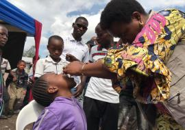 A child receives the vaccine on May 27, 2019