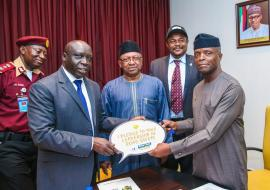L-R: JA Asom (FRSC), Dr Clement Peter (OIC/WHO), Dr Osagie Ohanire (HMSH, FMOH) and Vice President Yemi Osinbajo. Back: Dr Sydney Ibeanusi (Focal point/UNDARSIP)
