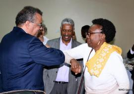 WHO Director General Dr Tedros (left) received by the Minister of Health Dr Dr Aceng (right) as WHO Uganda Country Representative- Dr Yonas Tegegn Woldemariam looks on