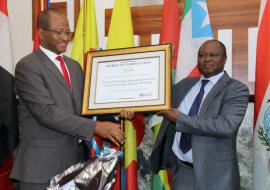 Dr Paul Mainuka handing over the award to Ethiopia's House of People's Representatives