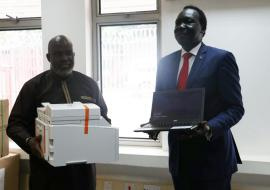 Dr Olu handing over the ICT equipment to Dr  Makur, Undersecretary, Ministry of Health