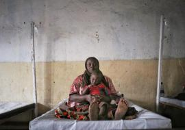 Benediction, suffering from Cholera, & his mother (GOMA), Photo: WHO/Savage S.