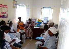 A QoC facility QI meeting facilitated by a QI coach at a PHC in the FCT