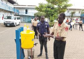 Security guards deployed at WHO office in Juba,  practices hand washing as a recommended measure to prevent the spread of #COVID-19