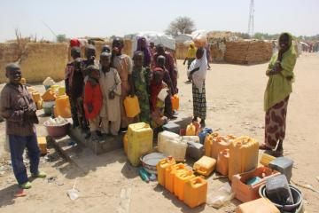 1.	Internally Displaced Persons cueing up for water at Muna IDPs camp. Photocredit: WHO/CE.Onuekwe
