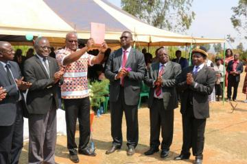 The Minister of Health, Honorable Atupele Muluzi waves high the newly launched National Alcohol Policy for Malawi