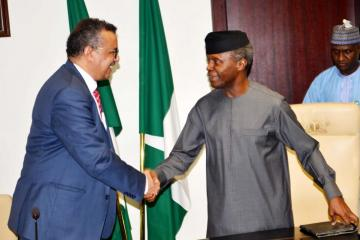 Nigeria's Vice President welcoming WHO Director General in his office at the Presidential Villa in Abuja