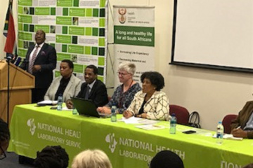 Dr Aaron Motsoaledi (Minister of Health), Ms Aneliswa Cele (Chief director, Environmental Health), Dr Brian Chirombo (OIC, WHO), Dr Kerrigan McCarthy (IMT Lead, NICD),  Ms Precious Matsoso (DG, Health)