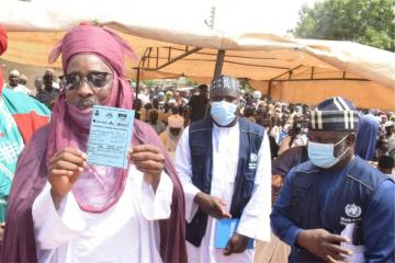 The Emir of Duste, His Royal Highness Dr Nuhu Muhammadu Sanusi showing off his vaccination card after receiving OCV during the flag-off
