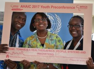 Dr Moeti in a selfie with young people after the town hall engagement at the AHAIC conference