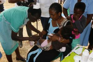 A child being vaccinated against Measles and Rubella during the launch of the Integrated Measles and Rubella Supplementary Immunization Activities campaign at Kasungu community ground