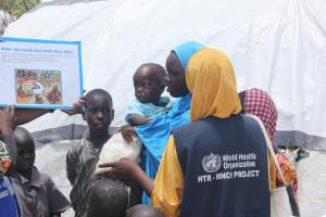 Mobile health team sensitizing   family members on cholera prevention methods. Photocredit: WHO/CE.Onuekwe