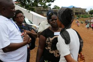 Mental Health Nurses engaging a community member affected by the mudslides disaster