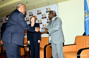 Prime Minister of Uganda Dr. Ruhakana Ruganda (left) greets WHO's Director of Program Management- Dr. Joseph Kabore (left) as Director of the U.S. Centers for Disease Control and Prevention, Dr. Brenda Fitzgerald (inset) looks on