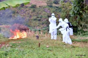 The burial team burning the bedding and and clothes of the dead MVD confirmed case in Kween district