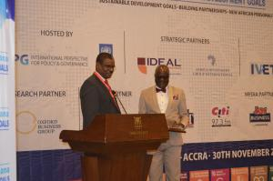 Dr Kaluwa presenting the award to  Dr Anyah