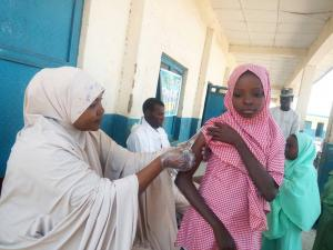 Picture showing a girl being vaccinated for yellow fever during the reactive vaccination campaign in Zamfara State, Nigeria