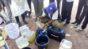 Mr Alex demonstrating water quality testing and treatment for National Public Health officers in Juba