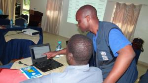 Dr Wamala Joseph helping the participants during the practical session on editing and deleting reports