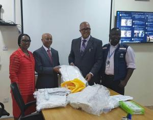 WHO country Representative Dr Wondimagegnehu Alemu hands over personal protective equipment to Chief Executive Officer of the Nigeria Centre for Disease Control Dr Chikwe Ihekweazu