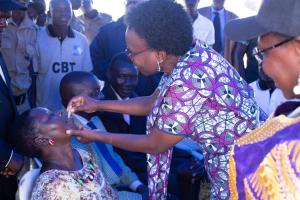 Minister of Health Dr Jane Ruth Aceng vaccinates a member of the community at the launch