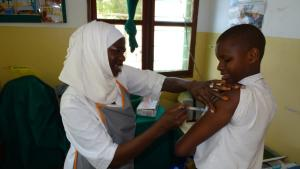 Grace receiving her second dose of HPV vaccine