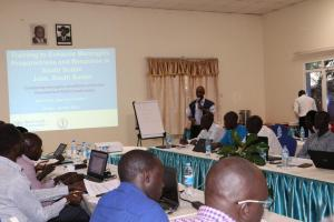 Dr Wamala making a presentation on meningitis surveillance