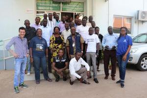 Participants in a group photo with the facilitators