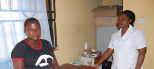 (Seated) Mrs Naomi Muyadeen and Head Nurse Esther Adepoju, Kuchigoro Primary Health Care Centre, Abuja.