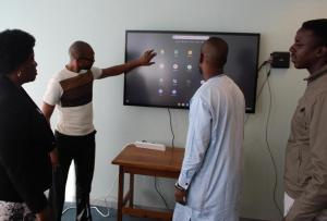 MoHW personnel getting a feel of the interactive equipment at the MoHW Headquarters